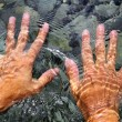 Hands underwater river water wavy shapes - Stock Photo