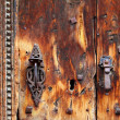 Aged grunge wood door weathered rusty handle - 