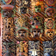 Mexican wooden mask handcrafted wood faces - Stock Photo