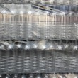 Bottle rows stacked wrapped in plastic - Stockfoto