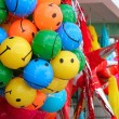 Colorful smiley balls and party pinata — Stock Photo