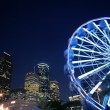 Ferris wheel at the fair night lights in Houston - Stock Photo