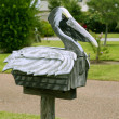 Stock Photo: Pelikan mail post wooden mailbox in Texas