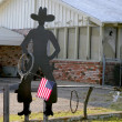 American flag with cowboy man silhouette - Stock Photo