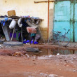 Africa Senegal street scene on humble city - Foto de Stock  