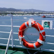 Cruise white boat handrail in blue Ibiza sea - Foto Stock