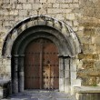 Ancient stone arch romanic architecture — Stock Photo