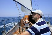 Sailor sailing in the sea. Sailboat over blue — Stock Photo