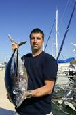 Angler fishing big game Albacore tuna on Mediterranean — Stock Photo