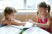 Beautiful little girls, homework at home — Stock Photo
