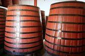 Natural wood wine golden barrel cellar — Stock Photo