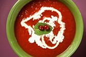 Tomato soup with basil and redcurrant — Stock Photo