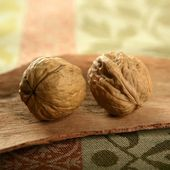 Two walnut over tablecloth — Stok fotoğraf