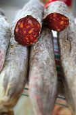 Cured red pepperoni in the mediterranean market — Stock Photo