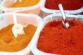 Saffron paprika curry yellow orange spices — Stock Photo