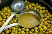 Olives in pickling brine background texture — Stock Photo