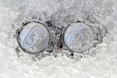 Two drink can iced submerged in frost ice — Stock Photo