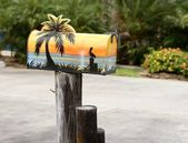 Fun artistic mail box with tropical sea paint — Stock Photo