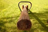 Old wooden teeter totter in the park — Stock Photo