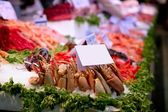Fish market in Spain with seafood and ice — Stock Photo