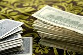 Dollar notes and poker cards, gambler tools — Stock Photo