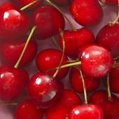 Cherry red fruits square macro on water — Stock Photo