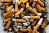Ashtray full of cigarettes. Dirty tobacco texture — Stock Photo