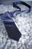 Left his tie on a modern white stones table — Stock Photo