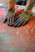 Children artist hands painting colorful — Stock Photo