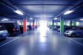 Backlit indoor car parking in blue cold light — Stock Photo
