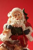 Santa Claus figurine over red background, studio — Stock Photo