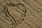 Hearth draw on the beach sand surface — Stock Photo