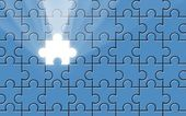 Blue puzzle with missing piece and light beam — Stock Photo