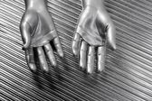 Hands open futuristic robot silver steel over gray — Stock Photo