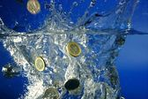 Euro coins fallin down to water — Stock Photo