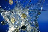 Euro coins fallin down to water — Stock Photo