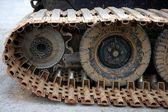 Caterpillars steel wheels from a snowblower — Stock Photo