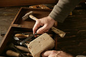 Craftman carpenter hand tools artist — Stock Photo