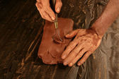 Artist man hands working red clay for handcraft — Stock fotografie