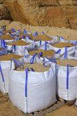 Sandbag white big bag sand sacks quarry — Stock Photo