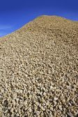 Crushed pound stone mound quarry — Stock Photo