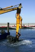 Marine dredging digging sea bottom black mud — Stock Photo