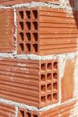 Brick corner edge red construction clay bricks — Photo