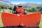 Snowplow tractor in mountain outdoor — Stock Photo