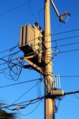 Light pole distribution transformer messy wires — Stock Photo