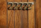 Rural hanger over wooden wall, horse stables — Stock Photo