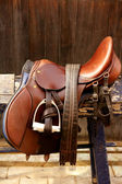 Horse riders complements, rigs, mounts, leather over wood — Stock Photo