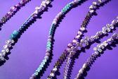 Color stones jewelry necklaces, purple background — Stock Photo