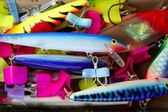 Colorful fishing saltwater fish lures box — Stock Photo