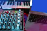 Audio mixer music desk under colorful lights — Stock Photo